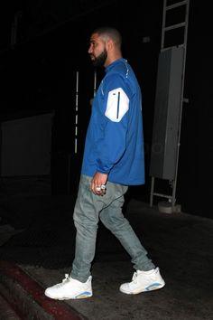 Drake wearing Nike College Alpha Fly Rush Kentucky Jacket