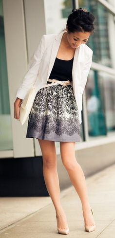 Wendy Nguyen - White blazer, black top, grey print skirt and black sandals