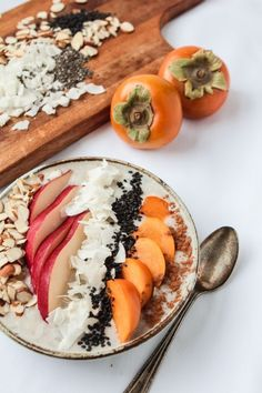 White Smoothie Bowl with Autumn Fruit. Excellent healthy choice for breakfast OR an afternoon snack. / The Modern Proper persimmons, pears, black sesame seeds, coconut, almond