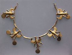 A Hittite gold necklace with flying eagles and pendant discs. Turkey, 1700-1500BC. Each of the gold hawk pendants, which are strung on gold wire, originally had three disc pendants attached, but several are now missing. British Museum