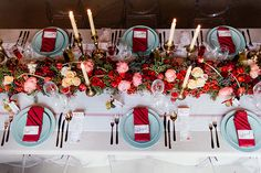 red and pink wedding flowers, french styled wedding, flower garland by Green goddess flower studio  - photo by Debbie Lourens http://ruffledblog.com/french-country-banquet-wedding-inspiration