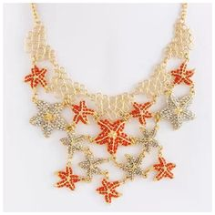 """D19 Coral Orange Crystal Bead Starfish Necklace ‼️PRICE FIRM‼️   Absolutely fabulous!  You are sure to get many compliments on this necklace.  Coral & rhinestone beaded starfish.  Gold color metal.   Cluster is approximately 6"""" long by 5"""" wide.  Lobster clasp.   21"""" long,  with 3"""" adjustable extender chain.  Comes with matching starfish earrings which hang about 1"""". Boutique Jewelry Necklaces"""