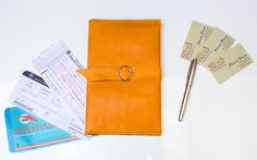 This is a soft leather handmade travel organizer that has  - 8 card holders - 2 passport holders - one zip pocket - 2 large pockets for small tablets or other devices. Smartphones can go either into zip pocket or into inside large pockets.  The dimensions are  31 cm x 24 cm  Smaller pockets are 5,5 cm width Middle pockets are 11,5 cm width Wide pocket is 23 cm