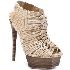 love the shoe!   The brand is L.A.M.B..  I could not wear that, (if I wanted to actually move or walk) but it sure is badass...