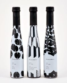 Beautiful monochromatic patterns for wine bottle packaging. BiancoNero from Greece. Food Packaging Design, Beverage Packaging, Bottle Packaging, Pretty Packaging, Brand Packaging, Coffee Packaging, Sleeve Packaging, Wine Label Design, Wine Bottle Design