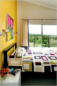 Great example of how you can add bright color to one wall and jazz up the room. Home in Amagansett, NY. Eric Striffler for The New York Times