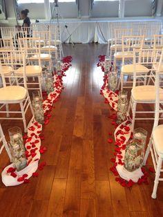 Indoor ceremony aisle décor at Herrington on the Bay