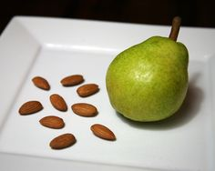Pears are great for fiber, which is essential for staying regular while traveling. Prewash and dry one small  pear (86 calories). Place it in a baggie with nine almonds (62 calories). Total calories: 148