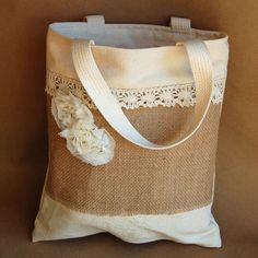 rustic tote - you know, if we have leftover lace and burlap!! (wouldn't this be great to have for our shoes/makeup/accesories on wedding day?)