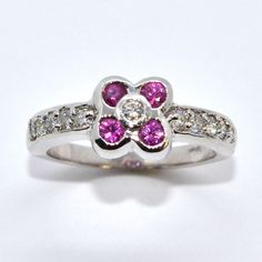 Looks like a tiny spring flower - diamonds & rubies in 14k white gold