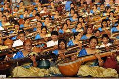 ALL TOGETHER NOW: Musicians participate in a concert featuring 1110 artists playing the veena, a classical Indian musical instrument, in Bangalore.
