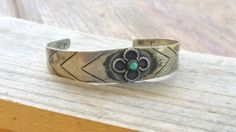 Check out this item in my Etsy shop https://www.etsy.com/listing/243208712/vintage-sterling-silver-bracelet-silver small cuff