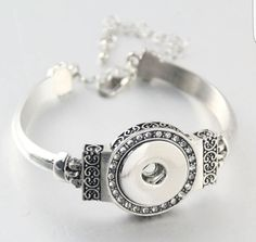 Check out this item in my Etsy shop https://www.etsy.com/listing/452969182/snap-button-bracelet-silver-tone-with