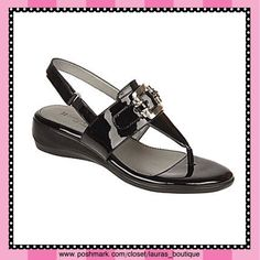 "NEW (No Box) Naturalizer Black Patent Thong Sandal NEW (No box) Naturalizer black patent thong sandals offer five elements of comfort plus a modern look! FEATURES: flexible footbed, featherweight outsole, stability-enhancing toe & heel, cushioning underfoot & breathable lining. The faux patent leather upper & decorative buckle on the vamp. The backstrap has an adjustable buckle, so you can customize the fit.  *Heel: 1 1/4"". *polyurethane upper/outsole, upper lining and sockliner, foam…"