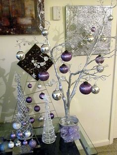 My modern tree with purple and silver ornaments! Metal tree shaped ornament holders from Crate & Barrel