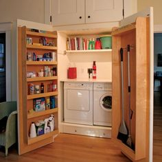 A smart and functional small laundry room behind two cabinet doors.