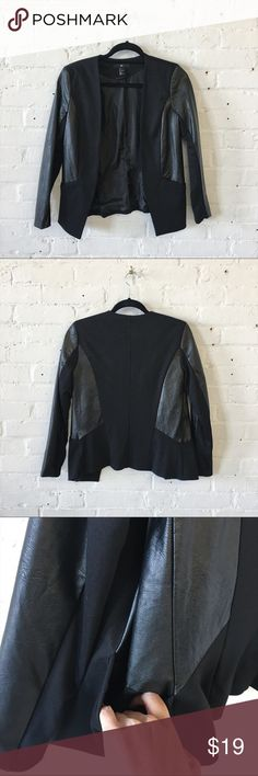 NWOT H&M Stretchy Faux Leather Jacket Blazer Really cute skinny fit blazer in faux leather with stretchy panels. Very slim fitting and perfect for work! Best fits XS/S.  New without tags Never worn Size 4  👉 Sorry no try-ons or trades 👉 Price is firm unless bundles 👉 Check out my closet for more cute NWT stuff H&M Jackets & Coats Blazers