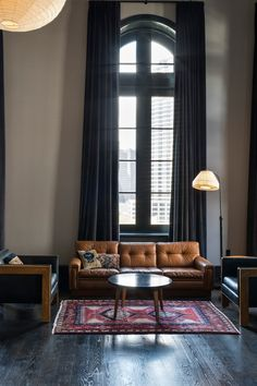 Ace Hotel New Orleans serving leather couch and black drape inspiration