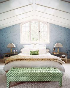Pop of color at the foot of the bed