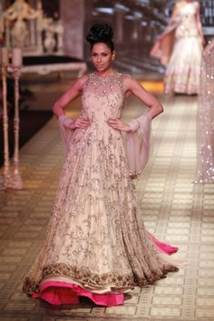 anarkali with pink underneath  by Manish Malhotra.  Bridal outfit