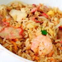 Nasi Goreng Recipe - Rice cooked with chicken and prawns. Garnished with fried eggs, this recipe is high on oriental flavors. Nasi Goreng literally means 'fried rice'. It is an Indonesian delicacy.