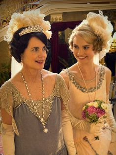 Lily James as Lady Rose MacClare at her debutante presentation at court, escorted by Cora, Countess of Grantham (Elizabeth McGovern). Downton Abbey