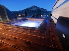 Isn't this view incredible? Tucked away on a secluded rooftop, this wood deck hot tub is the ultimate mountain escape.