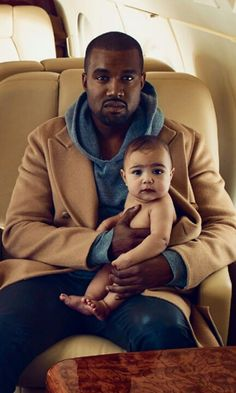 North West - absolutely gorgeous picture w/ her daddy. She is such a beautiful baby.