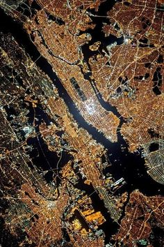 Premium Luster Photo Print New York, New York, the city that never sleeps. This satellite image taken at night shows that New York City's nickname is rightfully so. The city lights up the night sky in