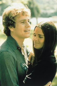 Still of Ali MacGraw and Ryan O'Neal in Love Story.  His preppy golden boy look paired with her intellectual, leggy brunette beauty was magical.  Her collegiate wardrobe of winter classics and funky glasses was early Ralph Lauren. Who could forget her little knit cap?
