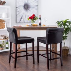 Provide guests with a place to relax with this set of comfortable leather stools. These black leather stools with hardwood legs are 36 inches tall and durable. They will make a nice addition to any home bar.