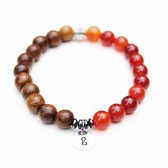 Havest Bracelet! Made with wooden beads & fire agate stone. #fallfashion #womensjewelry