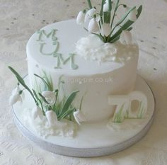 A winter style for this birthday cake for a lady who loves snowdrops x This is the first time making snowdrops and a i adapted a daffodil cutter to create them x