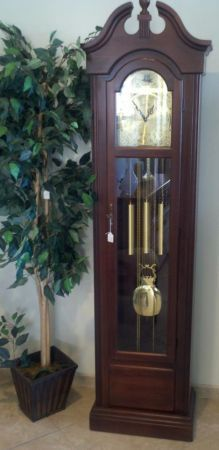 Gorgeous German grandfather clock with English chimes, original manual, and vial of oil.      Yesterdays Treasures Consignment    5829 Lone Tree Way Suite J    Antioch    925 - 233 - 4547