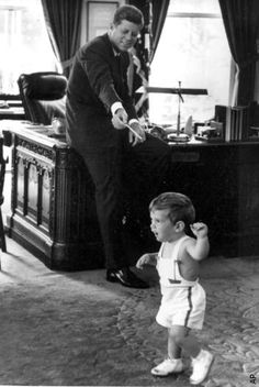 John F. Kennedy plays with son John Jr. in the Oval Office of The White House.