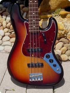 Sunburst finish, slab rosewood neck, tortoise;gard, the 1st owner changed the Stacked Pots out for a 1964 type 3-knob pot assembly like Jaco did on all his original basses, he found it far more