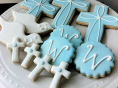 The initial cookies, mini crosses, and dove's olive branch are decorated using edible shimmer (see second picture)!  And the crosses and doves have sugar pearl detailing