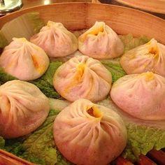 Soup dumplings from Joe's Shanghai:   18 Foods Everyone Must Try Before Leaving NYC