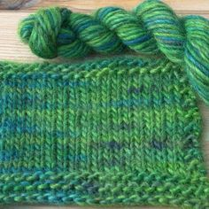 Knitted sample of Arcadia colourway on Archie Roving 50%BFL 50% Masham wool hand dyed yarn