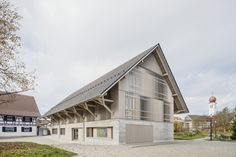 Steimle Architekten has converted a former barn in Kressbronn Library in Germany, featuring glazed openings screened by angled vertical louvres. Stuttgart Library, Clapboard Siding, Timber Roof, Agricultural Buildings, Garage Apartment Plans, Roof Structure, Building Facade, Building Homes, Log Cabin Homes