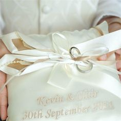 Wedding Rings On A Personalised Cushion