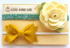 Felt flowers - Felt Flower headbands - felt flower newborn headbands with cream flower with glitter and Mustard bow. $28.00, via Etsy.