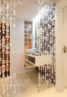 beaded curtain behind white reception desk Crystal Curtains, Beaded Curtains, White Reception Desk, Metal Plant Hangers, Coat Closet Organization, Shell Chandelier, Mermaid Room, Indian Living Rooms, Curtains With Blinds