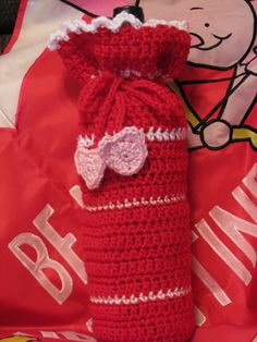 Wine Bottle Cozy/Gift Bag, Crocheted, Red, White & Pink with Pink Hearts    This cute wine bottle cozy is the perfect way to give a bottle of wine to that person who loves wine.    For custom requests, please contact me with a yarn color.    These items were made in a smoke-free, pet-loving home.    Thank you for looking at my items.    Pattern courtesy of: www.crochetspot.com with some changes.