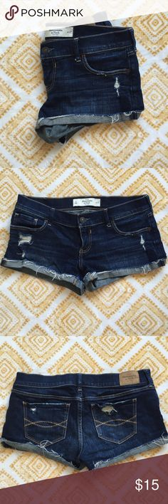 """Cuffed Destroyed Jean Shorts Abercrombie & Fitch 2"""" inseam cuffed destroyed dark wash jean shorts. Well loved but also very well taken care of. The back hem on the left butt pocket tends to flip down a little bit but ironing should help! Abercrombie & Fitch Shorts Jean Shorts"""