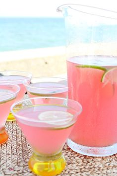 Beach House Cosmos 4 cups prepared limeade 2 cups vodka 1 cup cranberry juice 1/2 cup triple sec 12 lime slices
