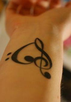 63 exemples de tatouage tournesol en photos - 7 https://tattoo.egrafla.fr/2016/02/08/modele-tatouage-note-musique/