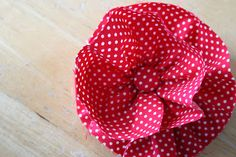 """Fabric Flower - use long strip of fabric (approx 1.5"""" wide); running stitch to gather flower and secure with needle and thread"""