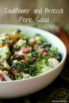 A delicious and healthy salad, combining broccoli, cauliflower, sunflower seeds, bacon, raisins and a sweet and tart dressing.