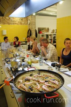 ... Show item 4 of 5. culinary instructor teaching cooking class in  Barcelona ...
